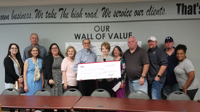 Keller Williams Realty CENLA presents check to Friendship House